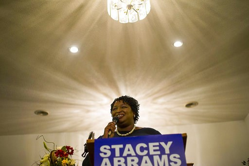"(Alyssa Pointer/Atlanta Journal-Constitution via AP). Georgia gubernatorial candidate Stacey Abrams speaks at Mt. Pisgah Primitive Baptist Church during a ""Get Out The Vote"" rally in Metter, Ga., Monday, Nov. 5, 2018."