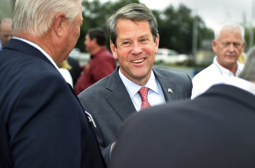 (Michael Holahan/The Augusta Chronicle via AP). Georgia Republican gubernatorial candidate Brian Kemp greets supporters during a campaign stop at Daniel Field in Augusta, Ga., Monday, Nov. 5, 2018.