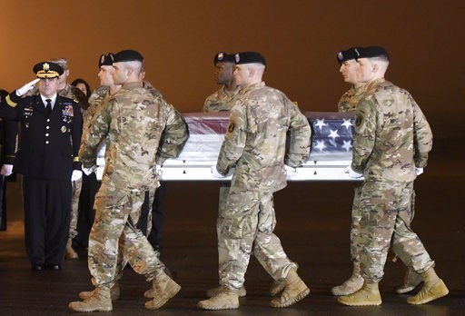 (AP Photo/Steve Ruark). Army Chief of Staff Gen. Mark A. Milley, left, salutes as an Army carry team moves a transfer case containing the remains of Maj. Brent R. Taylor at Dover Air Force Base, Del., on Tuesday, Nov. 6, 2018. According to the Departme...