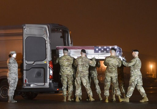 (AP Photo/Steve Ruark). An Army carry team loads into a vehicle a transfer case containing the remains of Maj. Brent R. Taylor at Dover Air Force Base, Del., on Tuesday, Nov. 6, 2018. According to the Department of Defense, Taylor, 39, of Ogden, Utah, ...