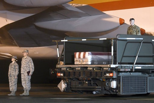 (AP Photo/Steve Ruark). A transfer case containing the remains of Maj. Brent R. Taylor sits on a loader at the Dover Air Force Base, Del., on Tuesday, Nov. 6, 2018. According to the Department of Defense, Taylor, 39, of Ogden, Utah, died Nov. 3, 2018, ...