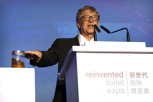 (AP Photo/Mark Schiefelbein). Bill Gates, former Microsoft CEO and co-founder of the Bill and Melinda Gates Foundation, gestures to a jar of human feces as he speaks at the Reinvented Toilet Expo in Beijing, Tuesday, Nov. 6, 2018. With a jar of human f...