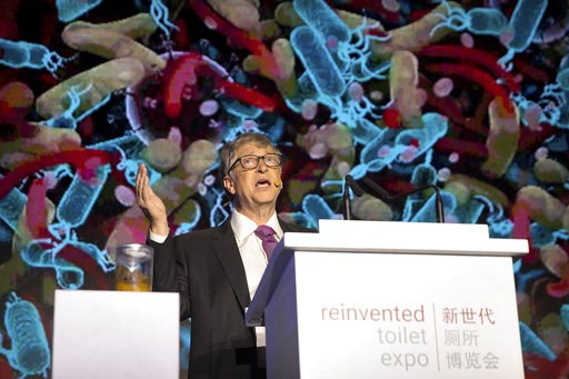 (AP Photo/Mark Schiefelbein). Bill Gates, former Microsoft CEO and co-founder of the Bill and Melinda Gates Foundation, speaks as a jar of human feces sits on a podium at the Reinvented Toilet Expo in Beijing, Tuesday, Nov. 6, 2018. With a jar of human...
