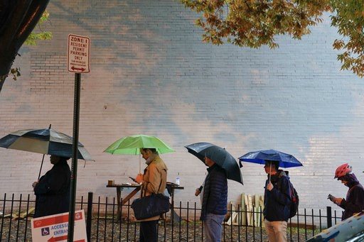 (AP Photo/Pablo Martinez Monsivais). Voters line up in the rain outside Bright Family and Youth Center in the Columbia Heights neighborhood in Washington, Tuesday, Nov. 6, 2018. Across the country, voters headed to the polls Tuesday in one of the most ...