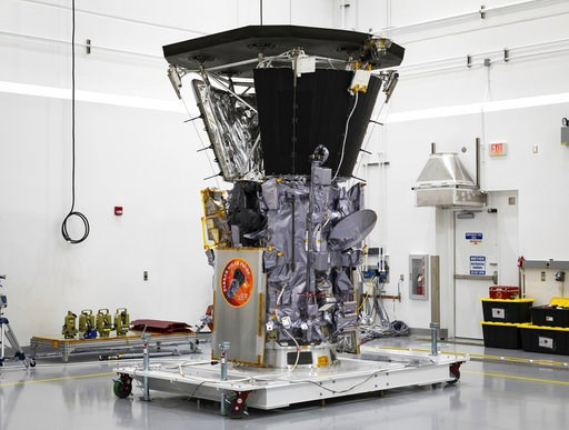 (Ed Whitman/NASA via AP, File). FILE - In this July 6, 2018 file photo, NASA's Parker Solar Probe sits in a clean room at Astrotech Space Operations in Titusville, Fla., after the installation of its heat shield. Parker has made its first close approac...