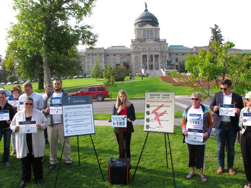 (AP Photo/Matt Volz, File). FILE - In this Aug. 22, 2018 file photo, Amanda Cahill of the American Heart Association speaks to a rally in support of a ballot initiative to raise the state's tobacco taxes in Helena, Mont. A measure to raise tobacco taxe...