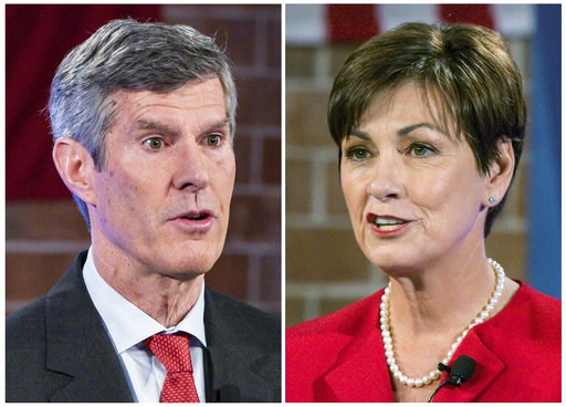 (Rodney White/Des Moines Register via AP, Pool, File). FILE - This combination of Oct. 10, 2018, file photos show Iowa Democratic gubernatorial candidate Fred Hubbell, left, and Iowa Republican Gov. Kim Reynolds during a debate in Des Moines.