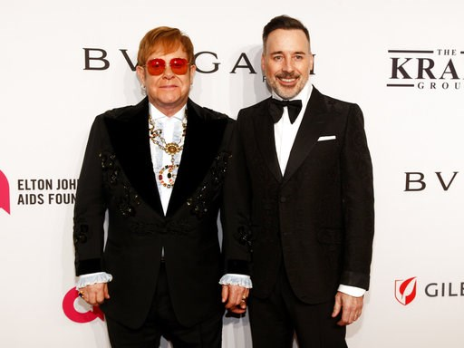 "(Photo by Andy Kropa/Invision/AP). Elton John, left, and David Furnish attend the Elton John AIDS Foundation's 17th annual ""An Enduring Vision"" benefit gala at Cipriani 42nd Street on Monday, Nov. 5, 2018, in New York."