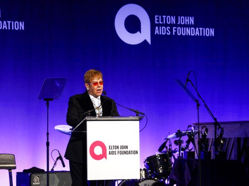 "(Photo by Andy Kropa/Invision/AP). Elton John speaks at the Elton John AIDS Foundation's 17th annual ""An Enduring Vision"" benefit gala at Cipriani 42nd Street on Monday, Nov. 5, 2018, in New York."