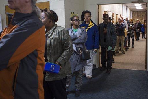 (Johanna Huckeba/St. Louis Post-Dispatch via AP). People wait in line to vote at First Presbyterian Church of Ferguson on Tuesday, Nov. 6, 2018, in Ferguson, Mo.