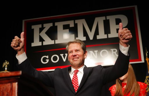 (AP Photo/John Bazemore). Georgia Republican gubernatorial candidate Brian Kemp gives a thumbs-up to supporters, Wednesday, Nov. 7, 2018, in Athens, Ga.