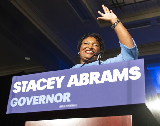 (AP Photo/John Amis). Georgia Democratic gubernatorial candidate Stacey Abrams speaks to supporters about a suspected run-off during an election night watch party, Tuesday, Nov. 6, 2018, in Atlanta. Abrams, the first black woman to be a major party nom...