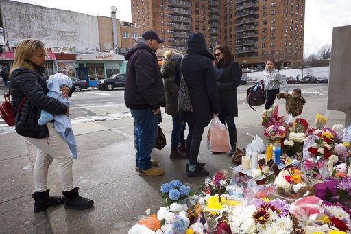 (AP Photo/Mark Lennihan, File). FILE - In this March 8, 2018 file photo, people gather at a sidewalk memorial for two children who were killed the previous week when they were struck by a car driven by a woman who likely had a seizure behind the wheel,...