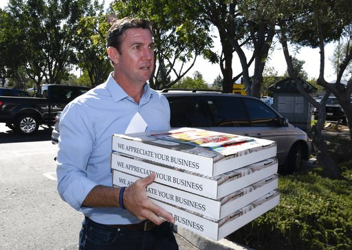 (AP Photo/Denis Poroy). Rep. Duncan Hunter, R-Calif.,brings pizza to campaign workers on Tuesday Nov. 6, 2018, in Santee, Calif. Hunter faces Democratic candidate Ammar Campa-Najjar in the race for Southern California's 50th district.