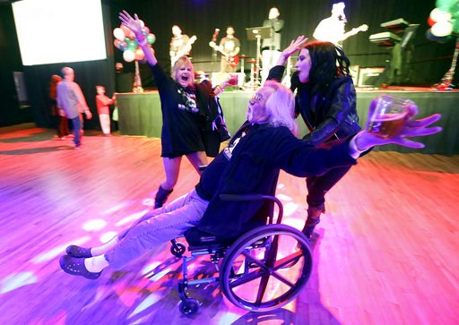 """(Kristin Murphy/The Deseret News via AP). """"We did it!"""" yells Shawn McDonald, center, as he celebrates with Teisha Martinez, left, and Aubrey Taylor after a local media outlet called results showing Proposition 2 passed at the Proposition 2 election nig..."""