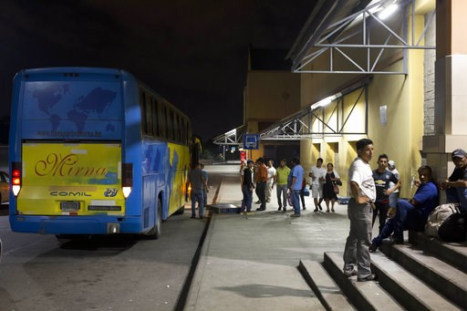 (AP Photo/Moises Castillo). In this Oct. 30, 2018 photo, Honduran migrants deported from Mexico wait to be transported home, at the Metropolitan Grand Central bus terminal in San Pedro Sula, Honduras, after failing to complete their journey to the U.S....