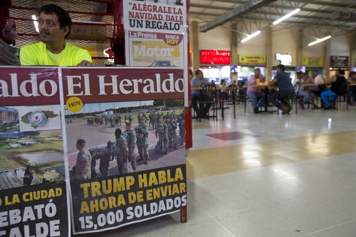 "(AP Photo/Moises Castillo). This Nov. 1, 2018 photo shows a newspaper kiosk advertising the day's headline that reads in Spanish: ""Trump now speaks of sending 15,000 soldiers"" to the U.S. border, at the Metropolitan Grand Central bus terminal in San Pe..."