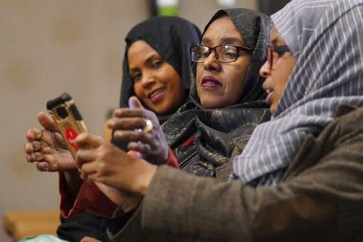 (Mark Vancleave/Star Tribune via AP). Hibo Omar, Muhubo Shire and Kin Kyani watch results at Democratic congressional candidate Ilhan Omar's election night headquarters in Minneapolis on Tuesday, Nov. 6, 2018. State Rep. Ilhan Omar has won Minnesota's ...