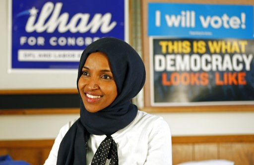 (AP Photo/Jim Mone). Democrat Ilhan Omar is interviewed by The Associated Press Wednesday, Nov. 7, 2018, in Minneapolis after winning Minnesota's 5th Congressional District race in Tuesday's election. She will be the first Somali American to serve in C...