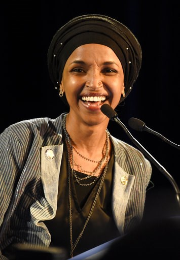 (AP Photo/Hannah Foslien). Democrat Ilhan Omar speaks after winning in Minnesota's 5th Congressional District race during the election night event held by the Democratic Party Tuesday, Nov. 6, 2018, in St. Paul, Minn. Omar became the first Somali-Ameri...