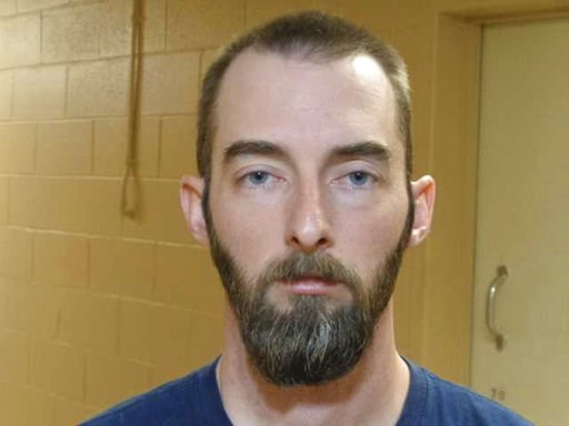 (Moore County Sheriff's Office via AP). This undated photo provided by Moore County Sheriff's Office in Dumas, Texas, shows Timothy Dean. Authorities say two Texas law enforcement officers are now charged in connection with a double homicide in upstate...