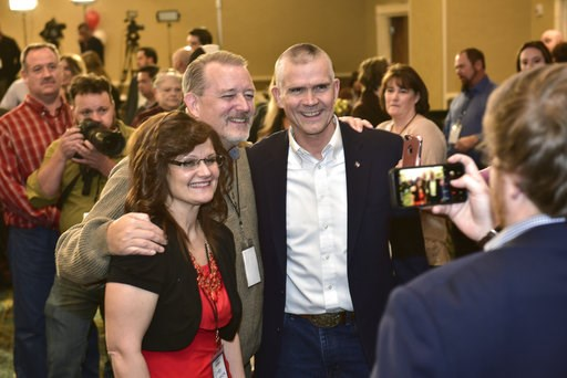 (AP Photo/ Eliza Wiley). Cindy Cronce, left, and Curt Edlin, center, of Helena, pose for a picture with Senate candidate Matt Rosendale after he greeted the room to say it would be a long night Tuesday, Nov. 6, 2018, in the Delta Hotel in Helena, Mont....