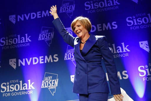 (AP Photo/John Locher). Susie Lee, a Democratic candidate for Nevada's third congressional district, takes the stage at a Democratic election night party Wednesday, Nov. 7, 2018, in Las Vegas. Lee defeated Republican candidate Danny Tarkanian. A female...