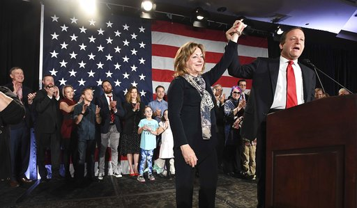 (Jerilee Bennett/The Gazette via AP). Colorado Governor-elect Jared Polis, right, lifts the hand of Lt. Governor-elect Dianne Primavera during his acceptance speech at the watch party for Colorado Democrats at the Westin Hotel in downtown Denver, Tuesd...