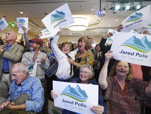 (Jerilee Bennett/The Gazette via AP). Democrats erupt when the Colorado Governor race is called for gubernatorial candidate Jared Polis at the Democratic watch party at the Westin Hotel in downtown Denver, Tuesday, Nov. 6, 2018.