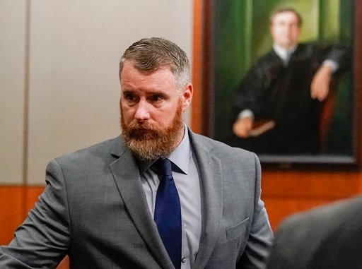 ( Melissa Phillip/Houston Chronicle via AP, Pool, File). FILE - In this June 13, 2018, file photo, Terry Thompson, accused of fatally choking John Hernandez, is shown in court in Houston. A jury on Monday, Nov. 5, convicted Thompson, the husband of a f...
