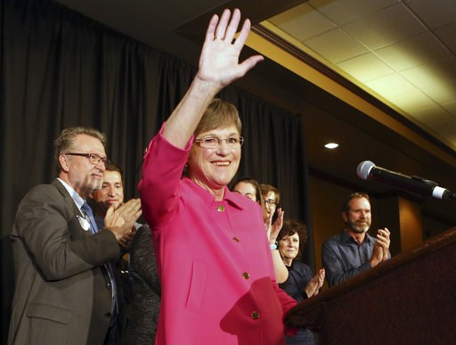 (Thad Allton /The Topeka Capital-Journal via AP). Democrat Laura Kelly waved to the crowd at the Ramada Hotel and Convention Center in Topeka after she won election Tuesday, Nov. 6, 2018, to become the next Kansas governor. On the left is her running m...
