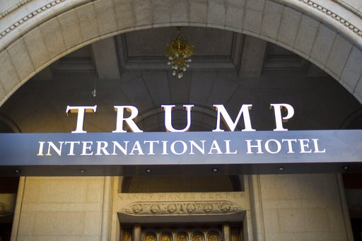 (AP Photo/Pablo Martinez Monsivais, File). FILE - This Monday, Sept. 12, 2016, file photo, shows the exterior of the Trump International Hotel in downtown Washington. A federal judge denied the Justice Department's efforts to halt legal proceedings in ...