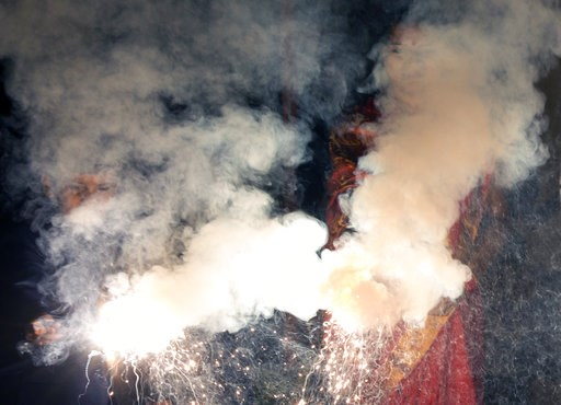 (AP Photo/Rajesh Kumar Singh). Seen through firework smoke, people celebrate Diwali in Allahabad, India, Wednesday, Nov. 7, 2018. Diwali, the festival of lights, is one of Hinduism's most important festivals, traditionally marked with symbolic firework...