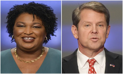 (AP Photos/John Amis, File). This combination of May 20, 2018, photos shows Georgia gubernatorial candidates Stacey Abrams, left, and Brian Kemp in Atlanta.  Democrats and Republicans nationwide will have to wait a bit longer to see if Georgia elects t...