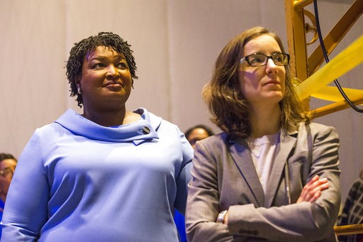 (Alyssa Pointer/Atlanta Journal-Constitution via AP). Georgia gubernatorial candidate Stacey Abrams, left, stands with her campaign manager, Lauren Groh-Wargo, before speaking to her supporters during an election night watch party at the Hyatt Regency ...