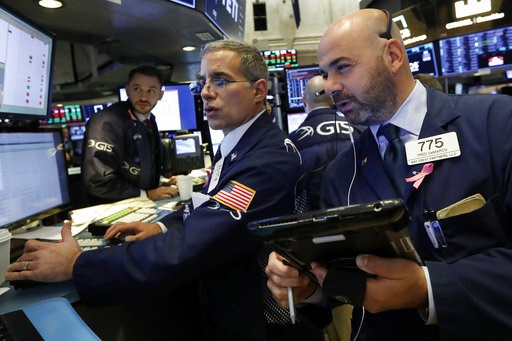(AP Photo/Richard Drew, File). FILE- In this Oct. 26, 2016, file photo specialist Anthony Rinaldi, left, works with trader Fred DeMarco on the floor of the New York Stock Exchange. The U.S. stock market opens at 9:30 a.m. EDT on Thursday, Nov. 8.