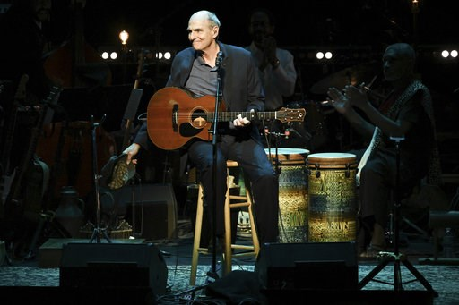 (Photo by Richard Shotwell/Invision/AP). James Taylor performs at JONI 75: A Birthday Celebration on Wednesday, Nov. 7, 2018, at the Dorothy Chandler Pavilion in Los Angeles.