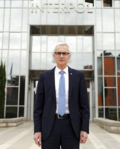 (AP Photo/Laurent Cipriani). Interpol Secretary General Jurgen Stock poses a the international police agency in Lyon, central France, Thursday, Nov.8, 2018.