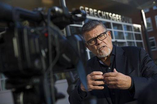 (AP Photo/Peter Dejong). Self-styled Dutch positivity guru Emile Ratelband answers questions during an interview in Utrecht, Netherlands, Thursday, Nov. 8, 2018. For Ratelband age really is just a number. In a legal battle that is stretching the debate...