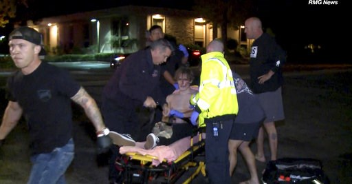 (RMG News via AP). In this image taken from video a victim is treated near the scene of a shooting, Wednesday evening, Nov. 7, 2018, in Thousand Oaks, Calif.  A hooded gunman dressed entirely in black opened fire on a crowd at a country dance bar holdi...