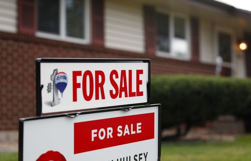 (AP Photo/David Zalubowski, File). FILE- In this Oct 2, 2018, file photo a for sale sign stands outside a home on the market in the north Denver suburb of Thornton, Colo. On Thursday, Nov. 8, Freddie Mac reports on this week's average U.S. mortgage rat...