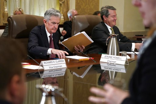 (AP Photo/Jacquelyn Martin, File). FILE- In this Oct. 31, 2018, file photo Federal Reserve Chair Jerome Powell, left, and Randal Quarles, vice chair for supervision, gather their things at the end of a Federal Reserve Board meeting at the Marriner S. E...