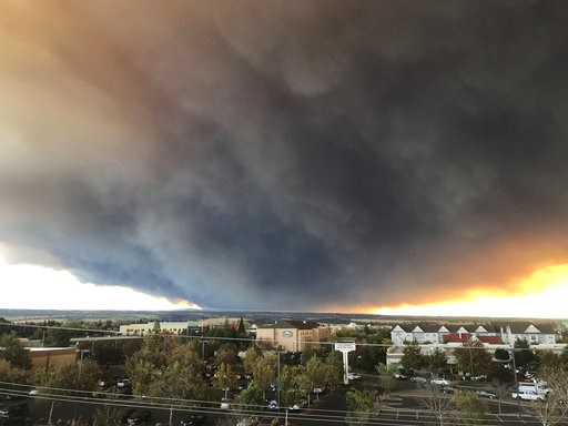 (David Little/Chico Enterprise-Record via AP). The massive plume from the Camp Fire, burning in the Feather River Canyon near Paradise, Calif., wafts over the Sacramento Valley as seen from Chico, Calif., on Thursday, Nov. 8, 2018. Authorities in North...