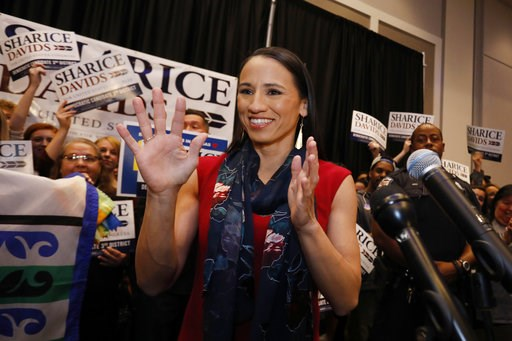 (AP Photo/Colin E. Braley). FILE - In this Tuesday, Nov. 6, 2018 file photo, Democratic house candidate Sharice Davids prepares to speak to supporters at a victory party in Olathe, Kan. Davids defeated Republican incumbent Kevin Yoder to win the Kansas...