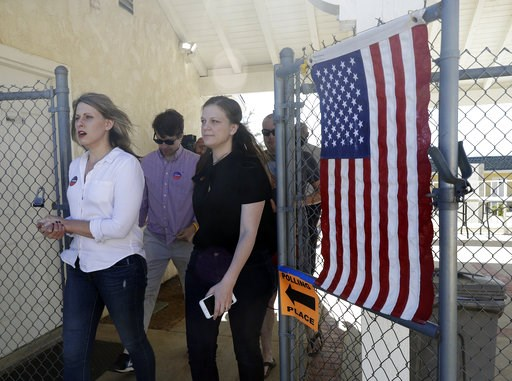 (AP Photo/Marcio Jose Sanchez). FILE - In this Tuesday, Nov. 6, 2018 file photo, Katie Hill, left, a Democratic candidate from California's 25th congressional district leaves a polling station after voting in Agua Dulce, Calif. Hill defeated Republican...