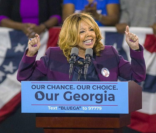 (Alyssa Pointer/Atlanta Journal-Constitution via AP, File). CORRECTS THAT REPUBLICAN REP. KAREN HANDEL FACED A RISK OF LOSING HER SEAT, NOT MCBATH, HER CHALLENGER - FILE - In a Friday, Nov. 2, 2018 file photo, Democrat Lucy McBath speaks during a rally...