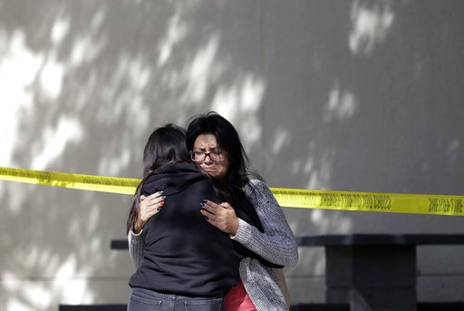 (AP Photo/Marcio Jose Sanchez). Mourners embrace outside of the Thousand Oaks Teen Center on Thursday, Nov. 8, 2018, where relatives and friends gathered in the aftermath of the Wednesday night mass shooting, in Thousand Oaks, Calif. Multiple people we...