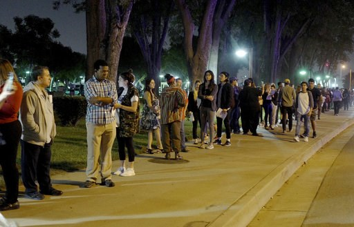 (Keith Birmingham/The Orange County Register via AP). A long line of people wait in the dark on Tuesday to vote at the Los Angeles County Registrar Recorders office in Norwalk, Calif., on Tuesday, Nov. 6, 2018.
