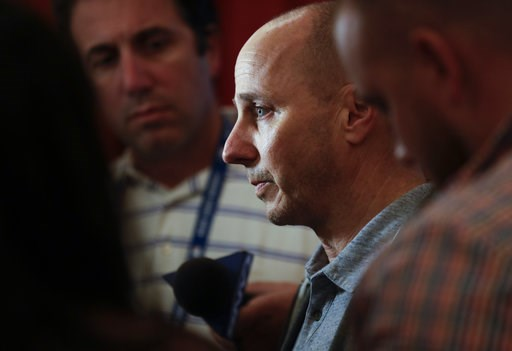 (AP Photo/Gregory Bull). New York Yankees general manager Brian Cashman, center, speaks to reporters during the baseball GM meetings Wednesday, Nov. 7, 2018, in Carlsbad, Calif.
