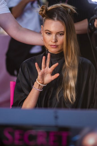 (Photo by Charles Sykes/Invision/AP). Behati Prinsloo appears backstage during hair and makeup at the 2018 Victoria's Secret Fashion Show at Pier 94 on Thursday, Nov. 8, 2018, in New York.